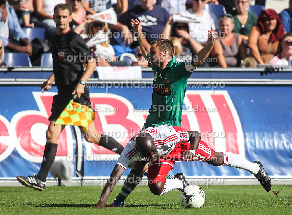 12.08.2012, Red Bull Arena, Salzburg,  AUT, 1. FBL, Red Bull Salzburg vs SK Rapid Wien, 4. Runde, im Bild Ibrahim Sekagya, (FC Red Bull Salzburg, #23) und Steffen Hofmann, (SK Rapid Wien, #11) // during Austrian Football Bundesliga Match, 4th round, between FC Red Bull Salzburg and SK Rapid Wien at the Red Bull Arena, Salzburg Austria on 2012/08/12. EXPA Pictures © 2012, PhotoCredit: EXPA/ Roland Hackl