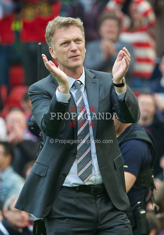 MANCHESTER, ENGLAND - Saturday, March 29, 2014: Manchester United's David Moyes applauds the supporters after his side's 4-1 victory over Aston Villa during the Premiership match at Old Trafford. (Pic by David Rawcliffe/Propaganda)