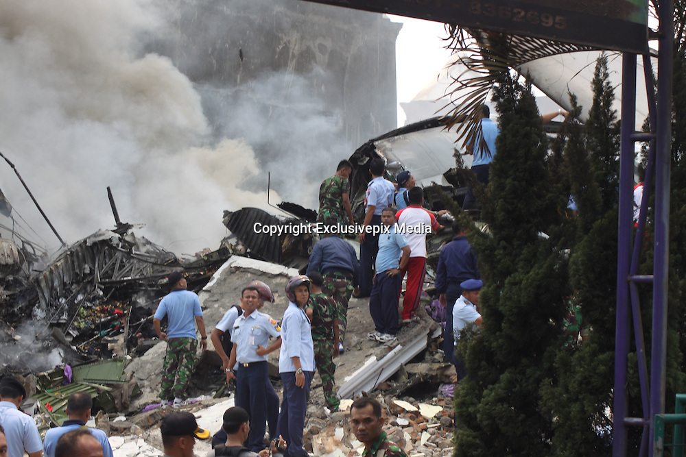 MEDAN, INDONESIA - JUNE 30: <br /> Indonesia rescue evacuated casualties from Indonesia air force Hercules C-130 that crashed at Medan on June 30 inNorth Sumatra, Indonesia. An Indonesian air force Hercules C-130 plane with 12 crew aboard has crashed into a residential neighborhood in the country's third-largest city Medan. A hospital official said at least five people were killed.<br /> ©Ahmad Ridwan Nasutin/Exclusivepix Media