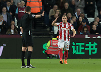 Football - 2017 / 2018 Premier League - West Ham United vs Stoke City<br /> <br /> Xherdan Shaqiri (Stoke City) shows referee Michael Oliver what he thinks of his decision at the London Stadium<br /> <br /> COLORSPORT/DANIEL BEARHAM