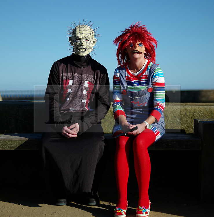 © Licensed to London News Pictures. <br /> 01/11/2014. <br /> <br /> Whitby, Yorkshire, United Kingdom<br /> <br /> Alan McDonugh from Middlesbrough is dressed as Pin Head and Cath Naylor as Chuckie during the Whitby Goth Weekend. <br /> <br /> The event this weekend brings together thousands of extravagantly dressed followers of Victoriana, Steampunk, Cybergoth and Romanticism who all visit the town to take part in celebrating Gothic culture. This weekend marks the 20th anniversary since the event was started by local woman Jo Hampshire.<br /> <br /> Photo credit : Ian Forsyth/LNP