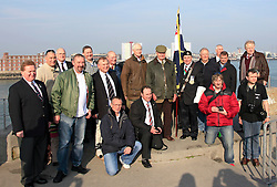 © under license to London News Pictures.  24/03/2011 Some of HMS Invincible's former crew members gathered on the dockside to watch the ship's final journey. HMS Invincible is towed from Portsmouth Dockyard on her final journey. She is to be delivered to Turkey where she will broken up for scrap. Picture credit should read: Bryan Moffat/London News Pictures