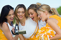 Cheerleaders Watching Video on Videocamera
