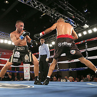 Cosme Rivera (R) squares off with Sergei Lipinets during a Telemundo Boxeo boxing match at the A La Carte Pavilion on Friday,  March 13, 2015 in Tampa, Florida.  Lipinets won the bout. (AP Photo/Alex Menendez)