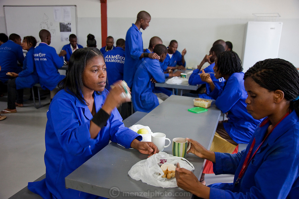 Mestilde Shigwedha, a diamond polisher for NamCot Diamonds in Windhoek, Namibia, drinks tea with a colleague during a break in the company cafeteria.  Diamonds are one of Namibia's major exports, and  while conflict diamonds grab the headlines, the fact is that the industry does provide a fairly decent living for many.