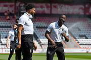 Timothy Fosu-Mensah (21) of Fulham and Jean Michael Seri (24) of Fulham share a joke on arrival before the Premier League match between Bournemouth and Fulham at the Vitality Stadium, Bournemouth, England on 20 April 2019.