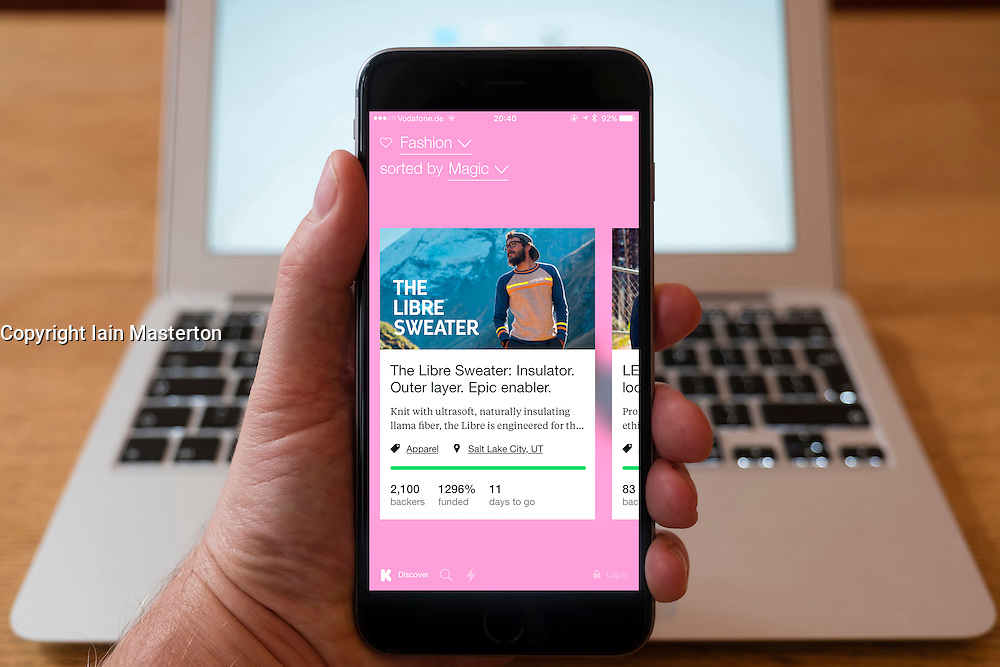 Using iPhone smartphone to display Kickstarter crowdfunding website which aims to raise funds for startup companies and projects,