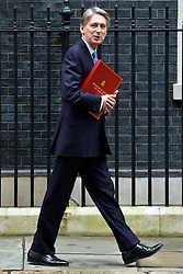 © Licensed to London News Pictures. 20/03/2013. Westminster, UK. Philip Hammond, Conservative MP, Secretary of State for Defence,..Chancellor Of The Exchequer George Osborne poses for photographers whilst holding his red ministerial box outside 11 Downing Street In London, before presenting his annual budget to parliament today 20th March 2013. Photo credit : Stephen Simpson/LNP