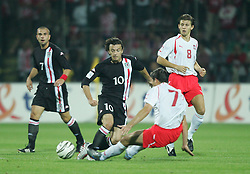 WARSAW, POLAND - WEDNESDAY, SEPTEMBER 7th, 2005: Wales' Simon Davies and Poland's Radoslaw Sobolewski during the World Cup Group Six Qualifying match at the Legia Stadium. (Pic by David Rawcliffe/Propaganda)