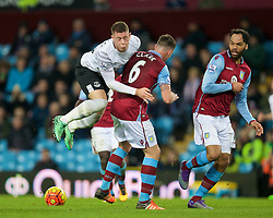 BIRMINGHAM, ENGLAND - Tuesday, March 1, 2016: Everton's Ross Barkley is tackled by Aston Villa's Ciaran Clark during the Premier League match at Villa Park. (Pic by David Rawcliffe/Propaganda)
