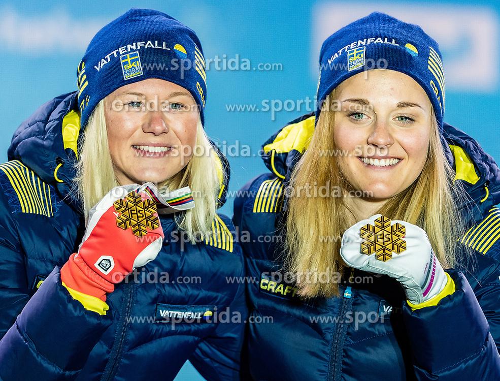 24.02.2019, Medal Plaza, Seefeld, AUT, FIS Weltmeisterschaften Ski Nordisch, Seefeld 2019, Langlauf, Damen, Teambewerb, Siegerehrung, im Bild Weltmeisterin und Goldmedaillengewinnerin Stina Nilsson, Maja Dahlqvist (SWE) // World champion and Gold medalist Stina Nilsson Maja Dahlqvist of Sweden during the winner ceremony for the ladie's cross country team competition of FIS Nordic Ski World Championships 2019 at the Medal Plaza in Seefeld, Austria on 2019/02/24. EXPA Pictures © 2019, PhotoCredit: EXPA/ Stefan Adelsberger