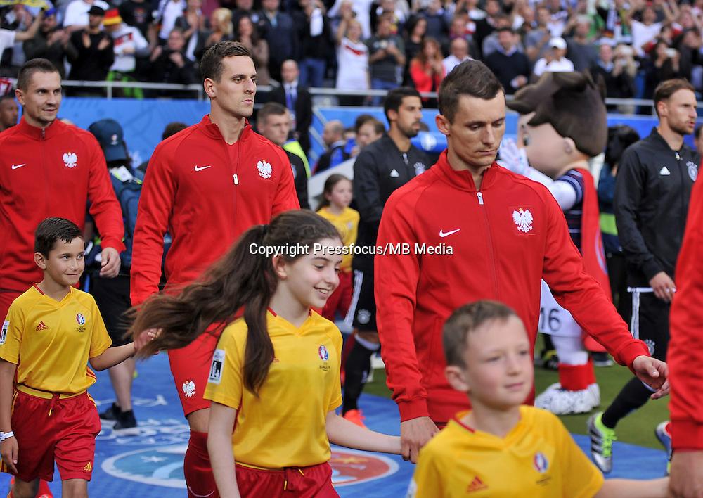 2016.06.16 Saint-Denis<br /> Pilka nozna Euro 2016<br /> mecz grupy C Polska - Niemcy<br /> N/z Arkadiusz Milik, Krzysztof Maczynski<br /> Foto Lukasz Laskowski / PressFocus<br /> <br /> 2016.06.16 Saint-Denis<br /> Football UEFA Euro 2016 group C game between Poland and Germany<br /> Arkadiusz Milik, Krzysztof Maczynski<br /> Credit: Lukasz Laskowski / PressFocus