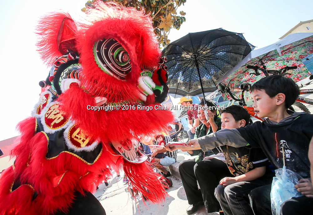 Lion dancers perform during the 117th annual Chinese New Year &quot;Golden Dragon Parade&quot; in the streets of Chinatown in Los Angeles, Saturday Feb. 13, 2016. (Photo by Ringo Chiu/PHOTOFORMULA.com)<br /> <br /> Usage Notes: This content is intended for editorial use only. For other uses, additional clearances may be required.