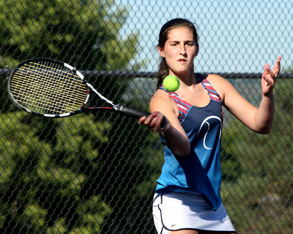 Southwestern's first singles player Morgan Johnson returns a volley during tennis action 9-23-15 at home against Maple Grove photo by Mark L. Anderson