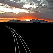 catching the light on railroad rails in Winona, Arizona