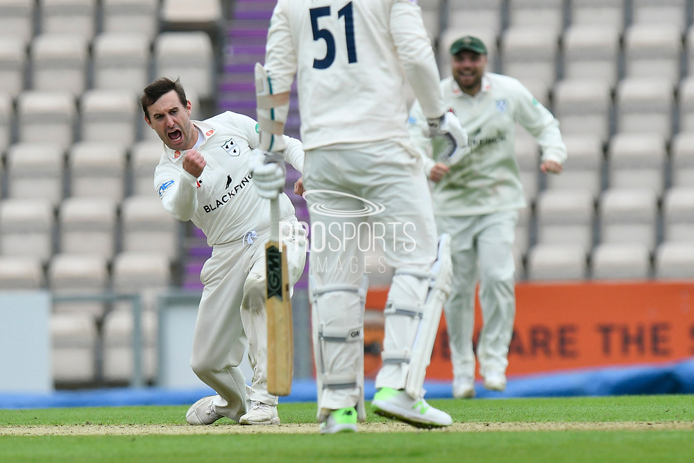 Wicket - Daryl Mitchell of Worcestershire celebrates taking the wicket of Kyle Abbott of Hampshire during the Specsavers County Champ Div 1 match between Hampshire County Cricket Club and Worcestershire County Cricket Club at the Ageas Bowl, Southampton, United Kingdom on 13 April 2018. Picture by Graham Hunt.