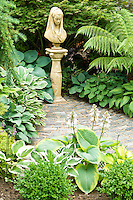 Various Hosta varieties with Boxos Sempervirens, Larix pendula to left and Tree Fern Dicksonia Antartica
