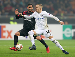 Austria Wien's Christoph Monschein and AC Milan's Mateo Musacchio battle for the ball
