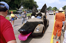 Stock photo of a giant dog head car with tongue sticking out