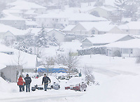 Old man winter hits the Comov Valley hard leaving many to shovel driveways and roadways in the Valleyview subdivision.  Courtenay, The Comox Valley, Vancouver Island, British Columbia, Canada.