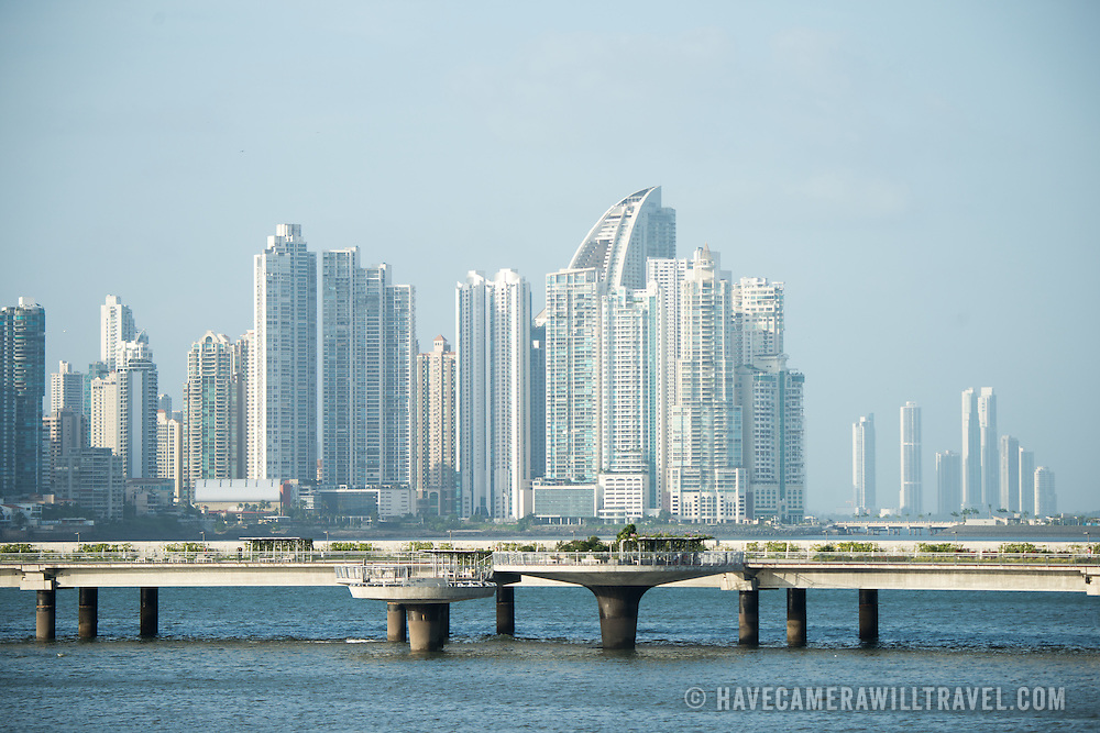 The modern skyscrapers of the skyline of the Punta Paitilla district of Panama City, Panama. In the foreground is the controversial Coastal Beltway (Cinta Costera III) that runs around Casco Viejo.
