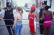 Three girls talking to policemen Notting Hill Carnival London 2003