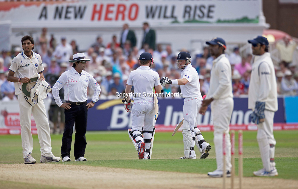 Umpire Asad Rauf and bowler Ishant Sharma (left) watche as Ian Bell (right) walks off (with Eoin Morgan) after Abhinav Mukund removes the bails and appeals (with captain Mahendra Singh Dhoni (right) to the square leg umpire to run him out during the second npower Test Match between England and India at Trent Bridge, Nottingham.  Photo: Graham Morris (Tel: +44(0)20 8969 4192 Email: sales@cricketpix.com) 31/07/11