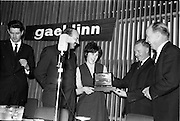 30/03/1963<br /> 03/30/1963<br /> 30 March 1963<br /> Gael - Linn Annual Debating Competition  for Secondary Schools awards presented at the Shelbourne Hotel, Dublin. Marie Ni Lafaigh, Captain of the Colaiste Mhuire Convent, Tourmakeady (Mayo) team receiving the team award Sciath Inniu, from Proinnsias Mac a'Bheatha (Stiurthoir Inniu). Also in the picture are Domhnall O'Morain, Cathaoirleach Gael Linn and Dr. P. Hillery, Minister for Education.