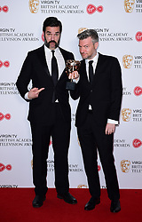 Rob Delaney presents Charlie Brooker with the award for Best Comedy and Comedy Entertainment Programme in the press room at the Virgin TV British Academy Television Awards 2017 held at Festival Hall at Southbank Centre, London. PRESS ASSOCIATION Photo. Picture date: Sunday May 14, 2017. See PA story SHOWBIZ Bafta. Photo credit should read: Ian West/PA Wire