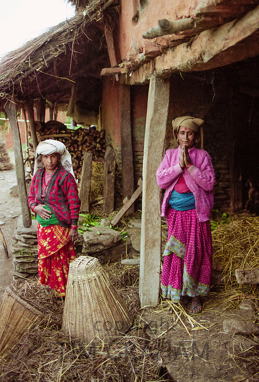 Namaste greeting from women in traditional clothing at home in the foothills of the Himalayas at Pokhara in Nepal