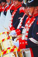 The Drum corps, in bright uniforms.