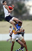 Adam Saad of the World XV111 takes a mark  during the AFL Under 16 championships match between South Pacific and World XVIII at Blacktown Olympic Park, Blacktown.