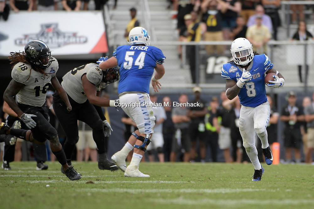 Memphis running back Darrell Henderson (8) rushes for yardage in front of Central Florida linebacker Shaquem Griffin (18) during the second half of the American Athletic Conference championship NCAA college football game Saturday, Dec. 2, 2017, in Orlando, Fla. Central Florida won 62-55. (Photo by Phelan M. Ebenhack)