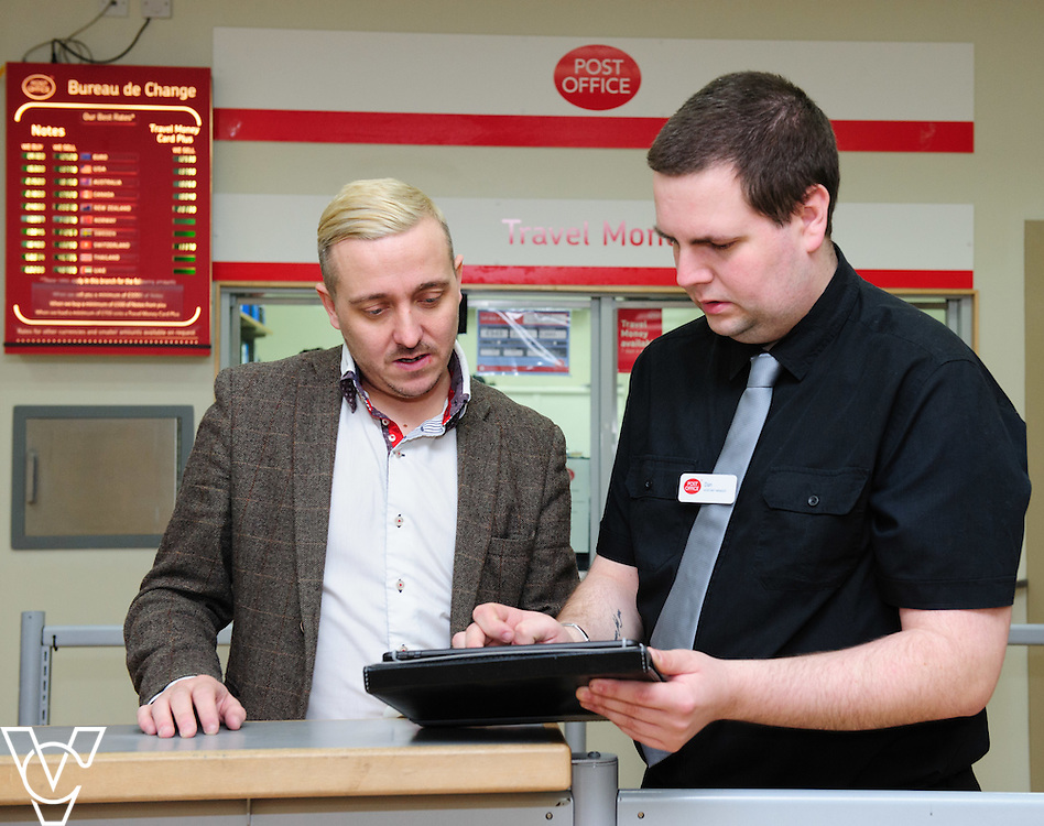 Pictured is Leicester Post Office Dan Keney, right, with customer Paul Rigby<br /> <br /> Leicester Post Office is trialling a tablet system that the team can use to capture the details of customers who are looking for a mortgage.  The details are send on to a mortgage specialist at a nearby large branch, who then gets in touch with the customer to arrange an appointment.<br /> <br /> Date: March 10, 2016