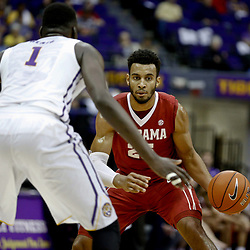 Jan 14, 2017; Baton Rouge, LA, USA; Alabama Crimson Tide forward Braxton Key (25) against  LSU Tigers forward Duop Reath (1) during the first half of a game at the Pete Maravich Assembly Center. Mandatory Credit: Derick E. Hingle-USA TODAY Sports