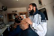 This Salafist is a hairdresser and wants to install a regime based on sharia. Sejenane is an example of a  Tunisian town that is in the grip of violent Salafis who rule here since April 2011. <br /> <br /> Tunisia, Sejnane, april 2012..Sejenane est sous l'emprise des  Salafistes violents qui y font la loi et y ont installé un régime de terreur depuis avril 2011. .Ce Salafiste modéré rejette la violence, il est coiffeur mais souhaite installer un regime basé sur le charia.