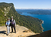 Hikers pause for the view at Lake Waikaremoana, in Te Urewera National Park, North Island, New Zealand For licensing options, please inquire.
