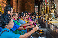 Bangkok, Thailand - December 29, 2013: people lighting incense at Wat Yai Chai Mongkhon Ayutthaya in Bangkok, Thailand on december 29th, 2013