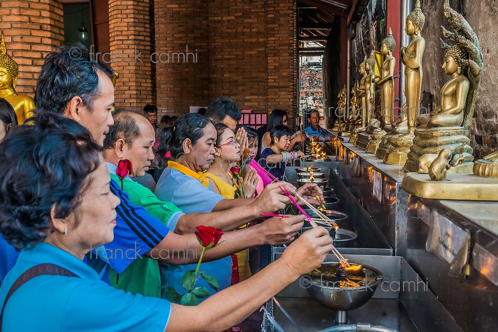 Bangkok, Thailand - December 29, 2013: people lighting incense at Wat Yai Chai Mongkhon Ayutthaya in Bangkok, Thailand on december 29th, 2013