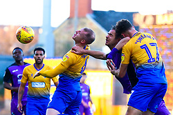 Neal Bishop of Mansfield Town heads the ball from an attacking Tom Pope of Port Vale - Mandatory by-line: Ryan Crockett/JMP - 17/11/2018 - FOOTBALL - One Call Stadium - Mansfield, England - Mansfield Town v Port Vale - Sky Bet League Two