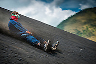 Nicaragua; May 2014. Volcano surfing; also known as ash boarding or volcano boarding; is a sport performed on the slopes of Cerro Negro near Leon in western Nicaragua. Riders hike up the volcano and slide down; sitting or standing; on a thin plywood or metal board. Volcano surfing is an extreme sport with the danger of falling off and getting cut by the rough volcanic ash. Protective gear; including jumpsuits and goggles; is used. Cerro Negro is also an active volcano although the last eruption was in 1999. Central America's largest and least populated country consists of lakes; volcanoes and Spanish colonial cities. Photo by Frits Meyst / MeystPhoto.com