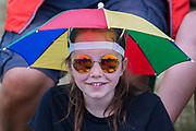 Light rain brings out various waterproofing options - The 2017 Latitude Festival, Henham Park. Suffolk 15 July 2017