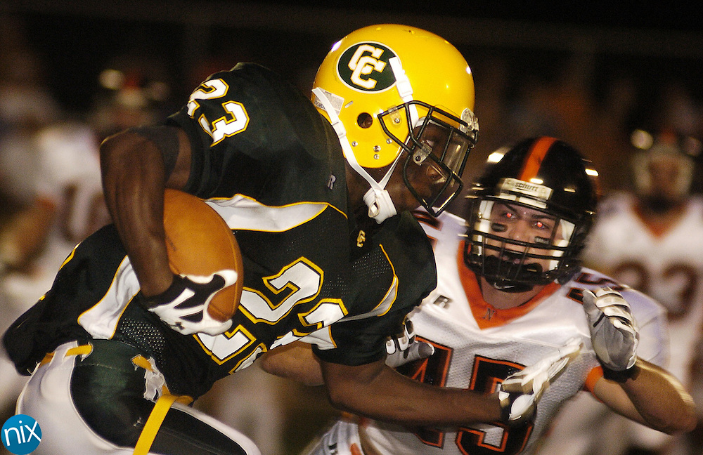 Central Cabarrus running back DJ Moore returns a punt past Northwest's Colton Edwards Friday night.