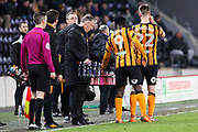 Hull City Manager Nigel Adkins hands out the drinks in a break of play during the EFL Sky Bet Championship match between Hull City and Millwall at the KCOM Stadium, Kingston upon Hull, England on 6 March 2018. Picture by Mick Atkins.