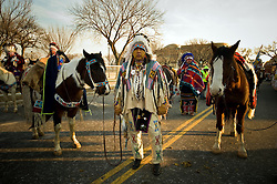 Native American Indians from Montana wait with their horses to march in a parade after the inauguration of Barack Obama as the 44th President of the United States of America January 20, 2009 in Washington, DC. The electric and emotional mood was contagious as Obama became the first African-American to be elected to the office of President in the history of the United States. .