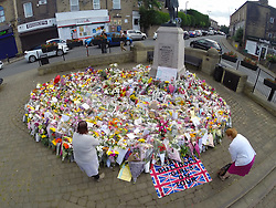 © Licensed to London News Pictures. 22/06/2016. Birstall UK. Picture shows the flowers left in Birstall on what would have been MP Jo Cox's 42nd birthday who was murdered last week. Photo credit: Andrew McCaren/LNP
