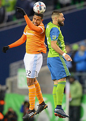 November 30, 2017 - Seattle, Washington, U.S - Soccer 2017: CLINT DEMPSEY (2) and LEONARDO (22) battle for a header as the Houston Dynamo play the Seattle Sounders in the 2nd leg of the MLS Western Conference Finals match at Century Link Field in Seattle, WA. (Credit Image: © Jeff Halstead via ZUMA Wire)
