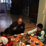 Dandong city, China, 11-2003..Ethnic Koreans, originally from what is now North Korea, eat breakfast in a border city in China...China help North Korea fight the Korean War in the 1950s and continue to have a defence treaty with the Stalinist country...Ruled by the messianic leader Kim Il Sung and his son Kim Jong Il since 1948, North Korea has stubbornly stuck to its juche (self-reliance) ideology and siege mentality, imposing one Stalinist economic plan after another. Floods, droughts and mismanagement in the 1990s plunged the country into a preventable famine, killing up to three million, or 13 percent of the population. It now depends heavily on Chinese aid...
