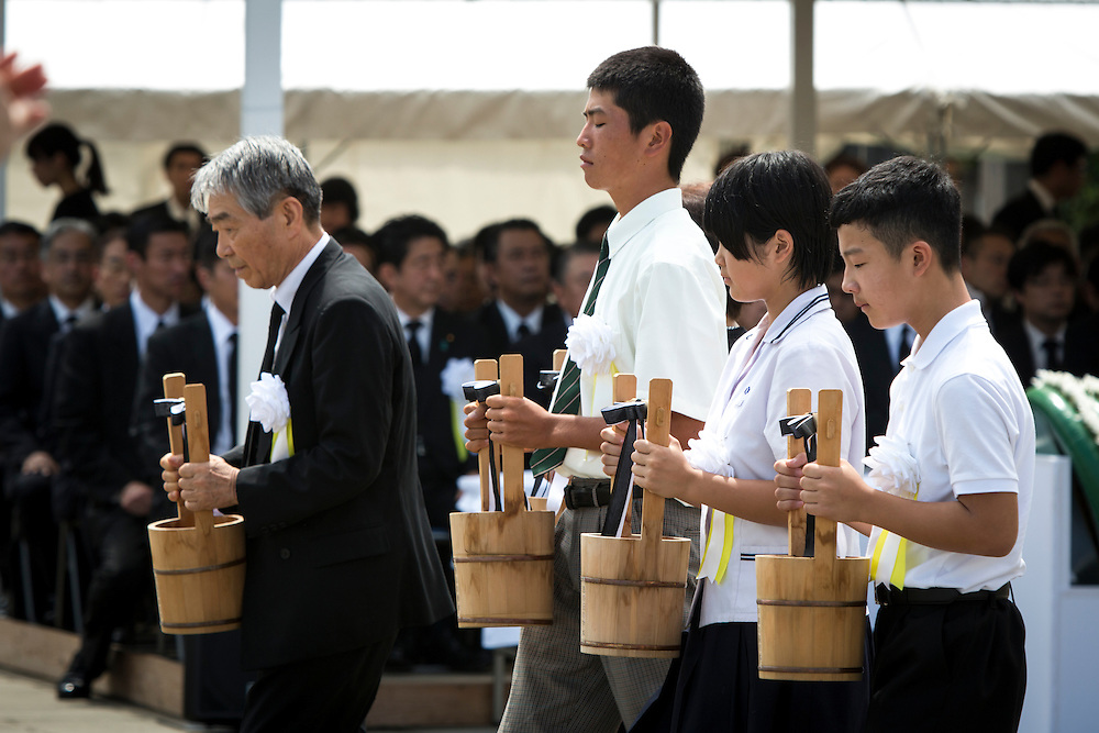 NAGASAKI, JAPAN - AUGUST 9 : Representatives of bereaved families and youth representatives offer water for the atomic bomb victims in front of the Peace Statue in Nagasaki Peace Park, Nagasaki, southern Japan, Tuesday, August 9, 2016. Japan marked the 71st anniversary of the atomic bombing on Nagasaki. On August 9, 1945, during World War II, the United States dropped the second Atomic bomb on Nagasaki city, killing an estimated 40,000 people which ended World War II. (Photo by Richard Atrero de Guzman/NURPhoto)