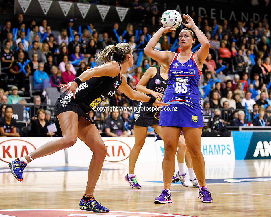 Northern Mystic's Cathrine Latu lines up a shot as Waikato BOP Magic's Leana De Bruin prepares to defend during the ANZ Championship netball match - Waikato BOP Magic v Northern Mystics at Claudelands Arena, Hamilton, New Zealand on Saturday 20 April 2014.  Photo:  Bruce Lim / www.photosport.co.nz